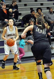 """<div class=""""source"""">Bobby Brockman</div><div class=""""image-desc"""">Caroline McMahan spots up for a three-pointer during her 10-point second quarter during the Lady Eagles' 59-25 home triumph over Whitefield Academy on Saturday.</div><div class=""""buy-pic""""><a href=""""http://web2.lcni5.com/cgi-bin/c2newbuyphoto.cgi?pub=085&orig=01-09_carolinemcmahan_1.jpg"""" target=""""_new"""">Buy this photo</a></div>"""