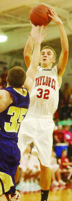 """<div class=""""source"""">Bobby Brockman</div><div class=""""image-desc"""">Chase Cox rises up for two of his 26 points in Taylor County's 64-53 home triumph over Campbellsville.</div><div class=""""buy-pic""""><a href=""""http://web2.lcni5.com/cgi-bin/c2newbuyphoto.cgi?pub=085&orig=01-12%2BChaseCox.jpg"""" target=""""_new"""">Buy this photo</a></div>"""
