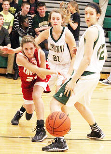 """<div class=""""source"""">Dennis George</div><div class=""""image-desc"""">Becca Orberson slips a pass through on the baseline around Green County's Kayla Bale (21) and Whitney  Perian (42) in Taylor County's 56-51 road triumph over the Lady Dragons on Tuesday night.</div><div class=""""buy-pic""""><a href=""""/photo_select/49627"""">Buy this photo</a></div>"""