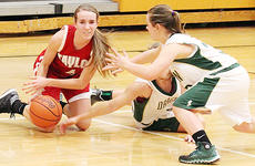 """<div class=""""source"""">Dennis George</div><div class=""""image-desc"""">Hannah Howard goes to the floor to pick up a loose ball in Taylor County's 56-51 victory at Green County on Tuesday night.</div><div class=""""buy-pic""""><a href=""""/photo_select/49626"""">Buy this photo</a></div>"""