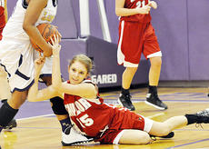 "<div class=""source""></div><div class=""image-desc"">Madison Lauer (15) forces a tie-up during Taylor County's 60-40 road triumph at Bardstown. The win gave the Lady Cardinals seven wins in their last 10 outings.</div><div class=""buy-pic""><a href=""/photo_select/49833"">Buy this photo</a></div>"