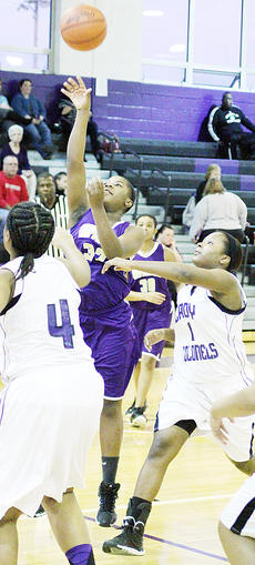 "<div class=""source"">Dennis George</div><div class=""image-desc"">Lady Eagle Nena Barnett hangs for a lane basket in first-round losses at Caverna in the Fifth Region All ""A"" Classic on Monday.</div><div class=""buy-pic""><a href=""http://web2.lcni5.com/cgi-bin/c2newbuyphoto.cgi?pub=085&orig=01-23_nenabarnett.jpg"" target=""_new"">Buy this photo</a></div>"