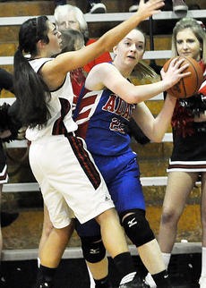 """<div class=""""source"""">Bobby Brockman</div><div class=""""image-desc"""">Harlee Smock (22) is trapped by Haley Wright in Adair County's 48-22 triumph at Taylor County on Tuesday night.</div><div class=""""buy-pic""""><a href=""""/photo_select/49885"""">Buy this photo</a></div>"""