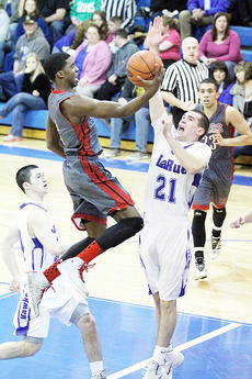 "<div class=""source"">Dennis George</div><div class=""image-desc"">Quentin Goodin glides to the basket for two of his 16 points at LaRue County. The sophomore also had 25 at North Hardin on Wednesday.</div><div class=""buy-pic""><a href=""/photo_select/50118"">Buy this photo</a></div>"