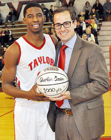 """<div class=""""source"""">Bobby Brockman</div><div class=""""image-desc"""">Quentin Goodin receives his 1,000-point club basketball from Cardinals' head coach Richard Gatewood. Goodin accomplished the feat in December in the North Laurel tournament.</div><div class=""""buy-pic""""><a href=""""http://web2.lcni5.com/cgi-bin/c2newbuyphoto.cgi?pub=085&orig=02-20_quentingoodin.jpg"""" target=""""_new"""">Buy this photo</a></div>"""