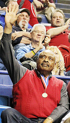 """<div class=""""source""""></div><div class=""""image-desc"""">Taylor County legend Clem Haskins waves to the crowd as he is introduced during the 2015 Kentucky High School Athletic Association State Basketball Tournament.</div><div class=""""buy-pic""""><a href=""""/photo_select/66487"""">Buy this photo</a></div>"""