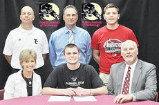 """<div class=""""source"""">Bobby Brockman</div><div class=""""image-desc"""">Caleb Wigginton signed a national letter of intent on Wednesday with Florida Tech. At the signing ceremony are his parents Dr. Scott and Elizabeth Wigginton and back, from left: Troy Young, his varsity head coach for his first two seasons and his calculus teacher who inspired his interest in engineering, coach Tim Peterson, his only four-year coach, and Elijah Myers, friend.</div><div class=""""buy-pic""""><a href=""""http://web2.lcni5.com/cgi-bin/c2newbuyphoto.cgi?pub=085&orig=04-21_calebwigginton.jpg"""" target=""""_new"""">Buy this photo</a></div>"""