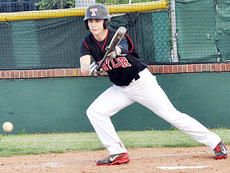 """<div class=""""source"""">Bobby Brockman</div><div class=""""image-desc"""">Dalton Brown lays a down a bunt single in the third inning of Taylor County's 1-0 game with Adair County. Brown had two hits vs. the Indians and scored three runs on Friday night in a 12-4 triumph at Metcalfe County.</div><div class=""""buy-pic""""><a href=""""/photo_select/51841"""">Buy this photo</a></div>"""
