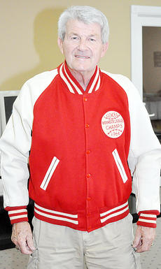 """<div class=""""source""""></div><div class=""""image-desc"""">Willard Smith proudly displays his Bourbon League championship jacket the Campbellsville Cokes won during the summer of 1964. The jacket, in excellent condition, fit Smith about as well as it did 50 years ago.</div><div class=""""buy-pic""""></div>"""