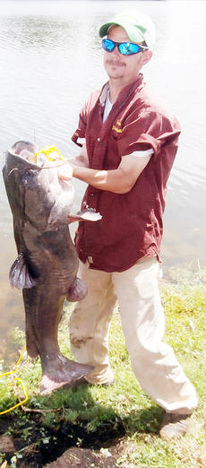 """<div class=""""source""""></div><div class=""""image-desc"""">J. Ramsey caught this nearly 50-pound flathead catfish at City Lake on June 13.</div><div class=""""buy-pic""""></div>"""