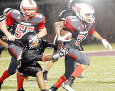 """<div class=""""source"""">Bobby Brockman</div><div class=""""image-desc"""">Tre Goodin scored on a reverse and on an 85-yard kick-off return in Taylor County 30-12 triumph over Campbellsville.</div><div class=""""buy-pic""""><a href=""""/photo_select/55174"""">Buy this photo</a></div>"""