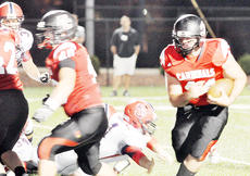 """<div class=""""source"""">Bobby Brockman</div><div class=""""image-desc"""">Brandon Williams sweeps left behind the block of Jack Miller (40) to give Taylor County an early lead vs. Russell County in the Cardinals' clash with the Lakers in Saturday night's Forcht Bank Bowl at Campbellsville University.</div><div class=""""buy-pic""""><a href=""""http://web2.lcni5.com/cgi-bin/c2newbuyphoto.cgi?pub=085&orig=08-29%2BBrandonWilliams.jpg"""" target=""""_new"""">Buy this photo</a></div>"""