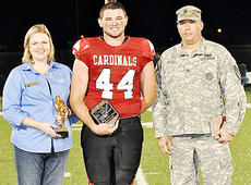 """<div class=""""source"""">Bobby Brockman</div><div class=""""image-desc"""">Brandon Williams is presented the Player of the Game honor from Brooke Thompson of Forcht Bank and Sgt. Gary Scott from the Army National Guard. </div><div class=""""buy-pic""""><a href=""""http://web2.lcni5.com/cgi-bin/c2newbuyphoto.cgi?pub=085&orig=08-29%2BPlayerofGame.jpg"""" target=""""_new"""">Buy this photo</a></div>"""