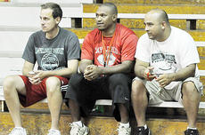 """<div class=""""source"""">Bobby Brockman</div><div class=""""image-desc"""">New Taylor County High School boys' basketball head coach Richard Gatewood Jr., left, joins Taylor County aides and parents Chris Goodin and Greg Oliver at Tuesday night's Lady Cardinal volleyball clash with Campbellsville. </div><div class=""""buy-pic""""><a href=""""http://web2.lcni5.com/cgi-bin/c2newbuyphoto.cgi?pub=085&orig=09-02%2BGatewoodGoodinOliver.jpg"""" target=""""_new"""">Buy this photo</a></div>"""