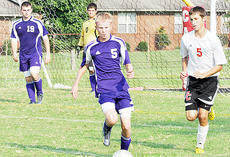 """<div class=""""source"""">Bobby Brockman</div><div class=""""image-desc"""">Eagle junior Dalton Hughes (5) attempts to advance the ball against Cardinal junior Jordan Nicholas (5) in the cross-town match. The 2-0 triumph was Taylor County's third victory this season while Campbellsville chalked up its second win two days later in a 3-0 shut-out (three goals by Weeks) at home vs. Hart County. The cross-town rivals will meet again at Campbellsville on Monday, Sept. 30.</div><div class=""""buy-pic""""><a href=""""http://web2.lcni5.com/cgi-bin/c2newbuyphoto.cgi?pub=085&orig=09-16_hughesnicholas.jpg"""" target=""""_new"""">Buy this photo</a></div>"""