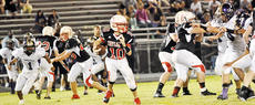 "<div class=""source"">Bobby Brockman</div><div class=""image-desc"">Taylor County Middle School quarterback Marcus Moore (10), above, tries to run around right end with Campbellsville's Daesean VanCleave (1) in pursuit.</div><div class=""buy-pic""><a href=""http://web2.lcni5.com/cgi-bin/c2newbuyphoto.cgi?pub=085&orig=09-16_marcusmoore.jpg"" target=""_new"">Buy this photo</a></div>"