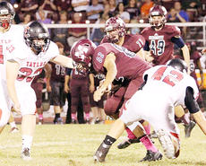 """<div class=""""source"""">Dennis George</div><div class=""""image-desc"""">Tyler Bragg (33) and Dylan Bright (42) converge on Marion County's Justin Dawson during Taylor County's 39-22 loss at Marion County on Friday night.</div><div class=""""buy-pic""""><a href=""""/photo_select/47533"""">Buy this photo</a></div>"""