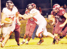 """<div class=""""source"""">Bobby Brockman</div><div class=""""image-desc"""">Taylor County junior Brandon Williams (44) uses a block from Slade Burris (54) to break loose around right end for some of his 168 yards vs. Marion County on Friday.</div><div class=""""buy-pic""""><a href=""""/photo_select/47531"""">Buy this photo</a></div>"""