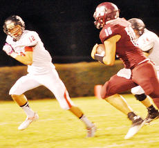 """<div class=""""source"""">Bobby Brockman</div><div class=""""image-desc"""">Connor Fair (12) cuts off Marion County's Hayden Taylor. Fair also had a 93-yard kick-off return for a touchdown starting the second half.</div><div class=""""buy-pic""""><a href=""""/photo_select/47532"""">Buy this photo</a></div>"""