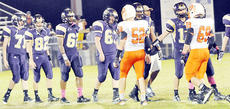 """<div class=""""source"""">Bobby Brockman</div><div class=""""image-desc"""">Despite a suggestion from the KHSAA to do away with post-game handshakes, Campbellsville and Williamsburg did the customary thing after Eagle-Yellow Jacket game on Friday night at Fryrear Field.</div><div class=""""buy-pic""""><a href=""""/photo_select/47625"""">Buy this photo</a></div>"""