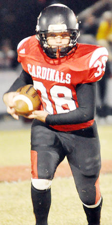 """<div class=""""source"""">Bobby Brockman</div><div class=""""image-desc""""> Jarrett Benningfield gave the Cardinals the early 7-0 advantage in their 35-20 Homecoming loss to Barren County.</div><div class=""""buy-pic""""><a href=""""/photo_select/47830"""">Buy this photo</a></div>"""