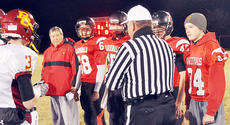 """<div class=""""source"""">Bobby Brockman</div><div class=""""image-desc"""">Taylor County head coach Eric Graves and game captains Logan Perry (68), Hunter Christie (15), Dylan Bright (42) and Ryan Cox (34) listen to referee Mike Moritz's pre-game instructions.</div><div class=""""buy-pic""""><a href=""""/photo_select/47831"""">Buy this photo</a></div>"""