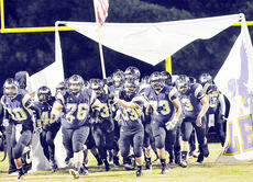 """<div class=""""source"""">Bobby Brockman</div><div class=""""image-desc"""">Campbellsville High School seniors Zach Durham (10), Dalton Couch (76) and D'Sean Murphy (73) lead the way with junior Hayden Webb (33) holding the American Flag as the Eagles come on the field in their regular-season finale vs. LaRue County on Friday night.</div><div class=""""buy-pic""""><a href=""""/photo_select/48182"""">Buy this photo</a></div>"""