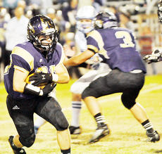 """<div class=""""source"""">Bobby Brockman</div><div class=""""image-desc"""">Hayden Webb (33) uses a block from fellow back Eric Lamer (3) to pick up first-down yardage in Campbellsville's 34-7 victory at home over LaRue County on Friday night. The Eagles host Harlan in the play-offs this Friday.</div><div class=""""buy-pic""""><a href=""""/photo_select/48183"""">Buy this photo</a></div>"""