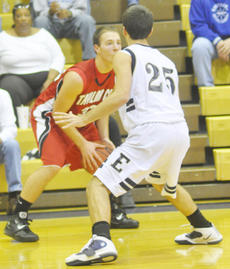 """<div class=""""source"""">Bobby Brockman</div><div class=""""image-desc"""">Chase Seaborne had two assists and a key steal down the stretch as Taylor County upended Elizabethtown 56-54.</div><div class=""""buy-pic""""><a href=""""/photo_select/26416"""">Buy this photo</a></div>"""