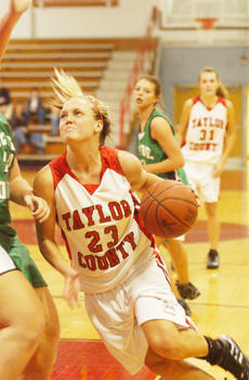 """<div class=""""source"""">Bobby Brockman</div><div class=""""image-desc"""">Cayla Rucker drives hard toward the basket in Taylor County's home opener on Thursday. The Lady Cardinals needed a 20-point fourth quarter to upend the Lady Waves 54-46 with Rucker leading the way with five three-pointers and 10 of her 26 points in the fo</div><div class=""""buy-pic""""><a href=""""/photo_select/8856"""">Buy this photo</a></div>"""