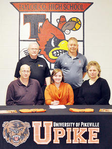"""<div class=""""source"""">Bobby Brockman</div><div class=""""image-desc"""">Megan Hedgespeth signed on Wednesday afternoon to continue her bowling career at the University of Pikeville. Joining her at the signing ceremony at Taylor County High School are, front: her parents John and Kim Hedgespeth and back: UPike coach Ron Damron and TCHS assistant principal Scott Franklin.</div><div class=""""buy-pic""""><a href=""""/photo_select/48824"""">Buy this photo</a></div>"""