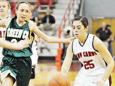 """<div class=""""source"""">Bobby Brockman</div><div class=""""image-desc"""">Lady Cardinal junior Haley Wright drives for two of her seven points vs. Green County's Laura Houk (24) in the first half of Taylor County's home setback to the Lady Dragons. TCHS hosts the four-team Taylor County Holiday Classic on Friday and Saturday.</div><div class=""""buy-pic""""><a href=""""/photo_select/49137"""">Buy this photo</a></div>"""