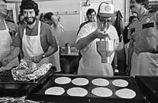 """<div class=""""source""""></div><div class=""""image-desc"""">A hungry crowd attended the fire department's annual pancake and sausage breakfast in 1982. Money raised went to purchase equipment.</div><div class=""""buy-pic""""></div>"""