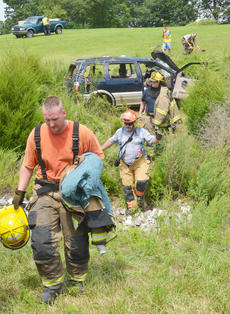 """<div class=""""source"""">Calen McKinney</div><div class=""""image-desc"""">Two people were injured in a one-vehicle crash last Thursday afternoon on KY 210, near Badger Road. The two were airlifted from the scene for treatment.</div><div class=""""buy-pic""""><a href=""""http://web2.lcni5.com/cgi-bin/c2newbuyphoto.cgi?pub=085&orig=210-badger_road_crash_1_color.jpg"""" target=""""_new"""">Buy this photo</a></div>"""