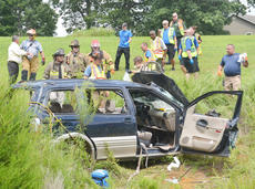 """<div class=""""source"""">Calen McKinney</div><div class=""""image-desc"""">Two people were injured in a one-vehicle crash last Thursday afternoon on KY 210, near Badger Road. The two were airlifted from the scene for treatment.</div><div class=""""buy-pic""""><a href=""""http://web2.lcni5.com/cgi-bin/c2newbuyphoto.cgi?pub=085&orig=210-badger_road_crash_2_color.jpg"""" target=""""_new"""">Buy this photo</a></div>"""