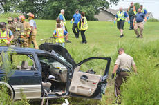 """<div class=""""source"""">Calen McKinney</div><div class=""""image-desc"""">Two people were injured in a one-vehicle crash last Thursday afternoon on KY 210, near Badger Road. The two were airlifted from the scene for treatment.</div><div class=""""buy-pic""""><a href=""""http://web2.lcni5.com/cgi-bin/c2newbuyphoto.cgi?pub=085&orig=210-badger_road_crash_4_color.jpg"""" target=""""_new"""">Buy this photo</a></div>"""