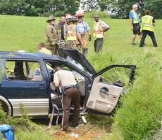 """<div class=""""source"""">Calen McKinney</div><div class=""""image-desc"""">Two people were injured in a one-vehicle crash last Thursday afternoon on KY 210, near Badger Road. The two were airlifted from the scene for treatment.</div><div class=""""buy-pic""""><a href=""""http://web2.lcni5.com/cgi-bin/c2newbuyphoto.cgi?pub=085&orig=210-badger_road_crash_5_color.jpg"""" target=""""_new"""">Buy this photo</a></div>"""