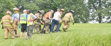"""<div class=""""source"""">Calen McKinney</div><div class=""""image-desc"""">Two people were injured in a one-vehicle crash last Thursday afternoon on KY 210, near Badger Road. The two were airlifted from the scene for treatment.</div><div class=""""buy-pic""""><a href=""""http://web2.lcni5.com/cgi-bin/c2newbuyphoto.cgi?pub=085&orig=210-badger_road_crash_6_color.jpg"""" target=""""_new"""">Buy this photo</a></div>"""