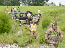 """<div class=""""source"""">Calen McKinney</div><div class=""""image-desc"""">Two people were injured in a one-vehicle crash last Thursday afternoon on KY 210, near Badger Road. The two were airlifted from the scene for treatment.</div><div class=""""buy-pic""""><a href=""""http://web2.lcni5.com/cgi-bin/c2newbuyphoto.cgi?pub=085&orig=210-badger_road_crash_7_color.jpg"""" target=""""_new"""">Buy this photo</a></div>"""
