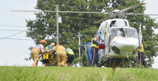 """<div class=""""source"""">Calen McKinney</div><div class=""""image-desc"""">Two people were injured in a one-vehicle crash last Thursday afternoon on KY 210, near Badger Road. The two were airlifted from the scene for treatment.</div><div class=""""buy-pic""""><a href=""""http://web2.lcni5.com/cgi-bin/c2newbuyphoto.cgi?pub=085&orig=210-badger_road_crash_8_color.jpg"""" target=""""_new"""">Buy this photo</a></div>"""