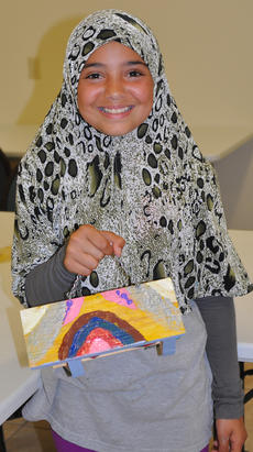 """<div class=""""source"""">Leslie Moore</div><div class=""""image-desc"""">Fatimah Alabusalim decorates her birdhouse with a rainbow.</div><div class=""""buy-pic""""><a href=""""/photo_select/45137"""">Buy this photo</a></div>"""