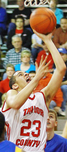 "<div class=""source""></div><div class=""image-desc"">Austin Webster scores inside for Taylor County in their home-court romp over Washington County.</div><div class=""buy-pic""></div>"