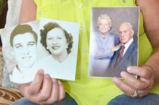"<div class=""source""></div><div class=""image-desc"">Brenda Anderson, who was adopted at 3 months old, holds photos of her biological parents, at left, Harold Stewart and Beulah Rogers, and her adopted parents, Jesse and Minnie Carmicle. She said she has spent several years searching to find out her family history and truly believes being adopted saved her life.</div><div class=""buy-pic""><a href=""/photo_select/46211"">Buy this photo</a></div>"