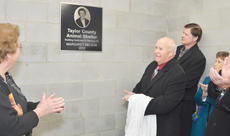 "<div class=""source"">Calen McKinney</div><div class=""image-desc"">Richard ""Dick"" Nelson unveils a plaque hung at the Taylor County Animal Shelter that dedicates the shelter's new building to his wife, the late Margaret Nelson, who loved animals and left the shelter nearly $45,000 in her will.</div><div class=""buy-pic""><a href=""/photo_select/42239"">Buy this photo</a></div>"