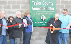 "<div class=""source"">Calen McKinney</div><div class=""image-desc"">Richard ""Dick"" Nelson, at right, cuts the ribbon at Taylor County Animal Shelter's new building on Tuesday. The building is dedicated to his wife, the late Margaret Nelson, who loved animals and left the shelter nearly $45,000 in her will. Beside Nelson is Taylor County Animal Shelter Director John Harris.</div><div class=""buy-pic""><a href=""/photo_select/42238"">Buy this photo</a></div>"