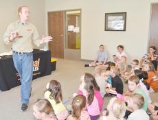 """<div class=""""source"""">Calen McKinney</div><div class=""""image-desc"""">Opferman shows a milk snake to the audience.</div><div class=""""buy-pic""""><a href=""""/photo_select/45412"""">Buy this photo</a></div>"""