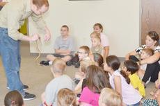 """<div class=""""source"""">Calen McKinney</div><div class=""""image-desc"""">Opferman tells the children that the European legless lizard has ears and can hear prey as it approaches.</div><div class=""""buy-pic""""><a href=""""/photo_select/45414"""">Buy this photo</a></div>"""