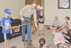 """<div class=""""source"""">Calen McKinney</div><div class=""""image-desc"""">Justice Perry, 9, and Simon Leachman, 7, help Opferman show this boa constrictor to the audience.</div><div class=""""buy-pic""""><a href=""""/photo_select/45415"""">Buy this photo</a></div>"""