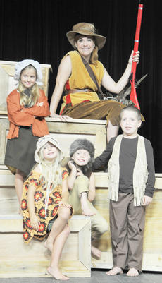 "<div class=""source"">Samantha Clark</div><div class=""image-desc"">Annie Oakley, played by Kelli Stanfield, is surrounded by Hannah Hansford, at top, with, from left, Hope Hansford, Reece Durham and Eli Durham.</div><div class=""buy-pic""></div>"
