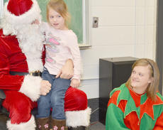 "<div class=""source"">Calen McKinney</div><div class=""image-desc"">Audrey Hicks, 4, of Campbellsville, tells Santa what she wants for Christmas this year.</div><div class=""buy-pic""><a href=""http://web2.lcni5.com/cgi-bin/c2newbuyphoto.cgi?pub=085&orig=Arts%2Band%2BCrafts%2B4.jpg"" target=""_new"">Buy this photo</a></div>"